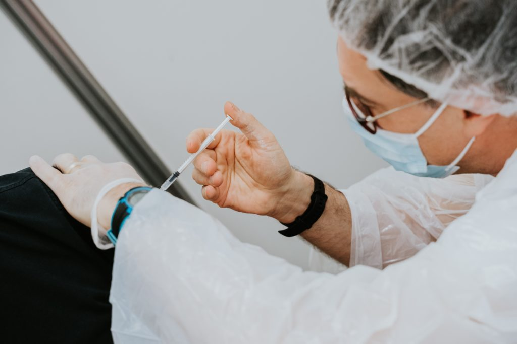 Alle beim Impfen mitnehmen: Mehrsprachige Impfkampagne und mobile Impfteams in Unterkünften für Geflüchtete